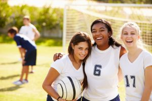 Three high school girls at soccer practice