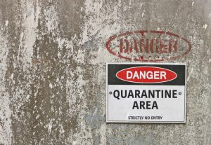 A sign reading Danger:Quarantine Area
