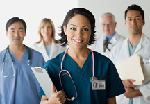 Two females and three male medical professionals stand in room